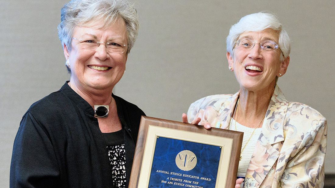 Ethics Committee Chair Linda K. Knauss, PhD (right), presents Mary Alice Fisher, PhD, with the 2016 APA Ethics Educator Award
