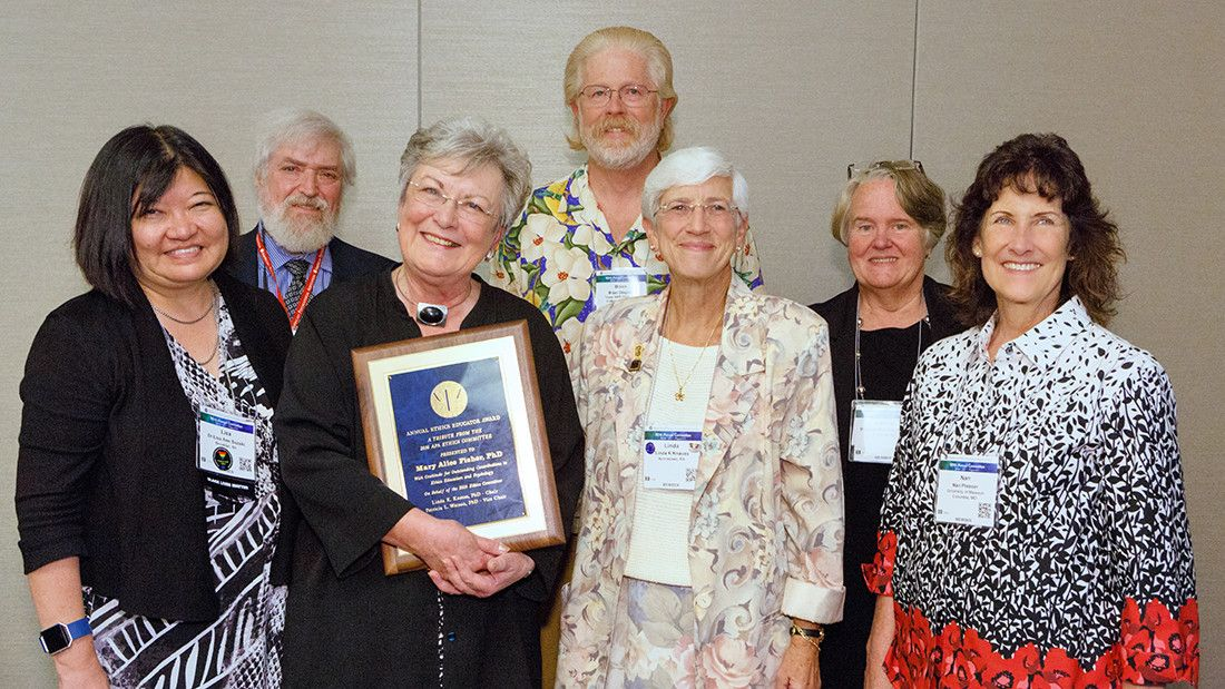 Ethics Educator Award winner Mary Alice Fisher, PhD (front row, second from left), with Ethics Committee members