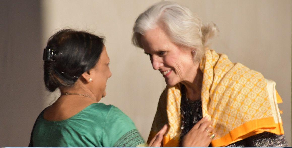 APA President Susan McDaniel, PhD, receives shawl from NAOP President Purnima Singh