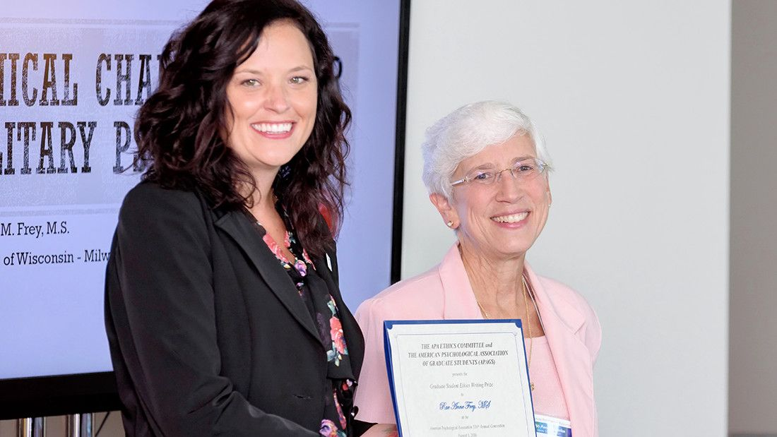 Ethics Committee Chair Linda K. Knauss, PhD, presents Rae Anne M. Frey, MS (left), with the 2016 Graduate Student Ethics Prize