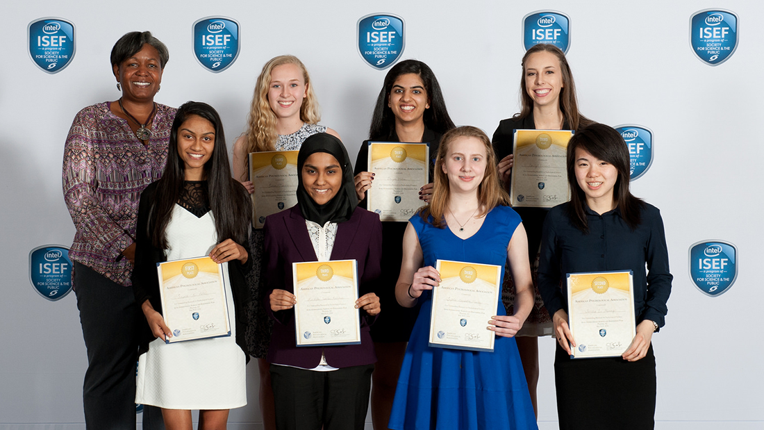 Recipients of APA awards for best projects representing psychological science at the 2016 Intel International Science and Engineering Fair. Bottom row, left to right: Sapna K. Patel, Kashfia Rahman, Sophia Hawley, and Jessica Li Huang. Top row, left to right: Dr. Ladonna Lewis (APA lead judge), Sarah Fendrich, Divya Vatsa, and Emily Wood. Not pictured: Nikhil Patel. (April Rietze Photography/Society for Science & the Public)