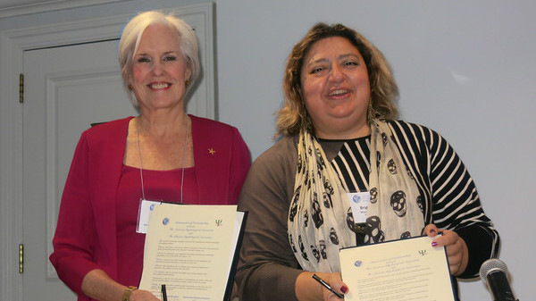 Susan McDaniel, PhD (left), and Brigitte Khoury, PhD, at signing of memorandum of understanding between APA and the Lebanese Psychological Association (LPA)