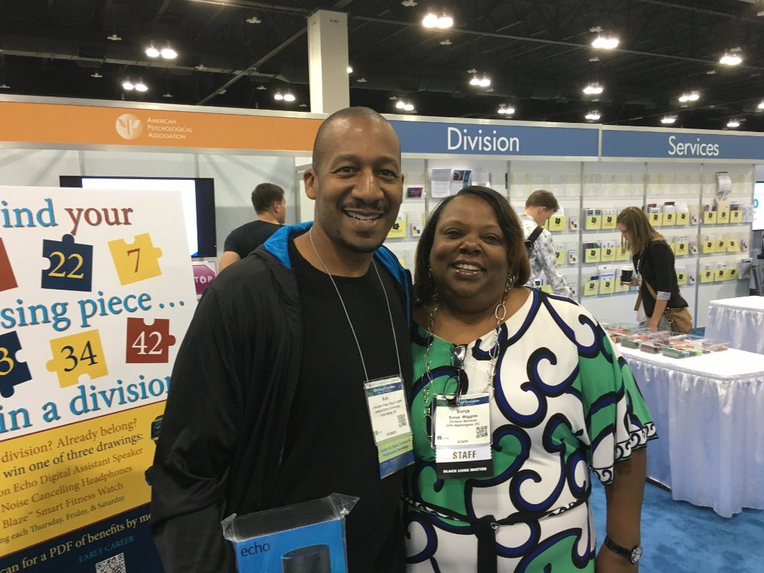 Ken Chew Jr., a member of Divs. 12 and 47, with APA staff member Sonja Wiggins, after winning the Division Services booth raffle